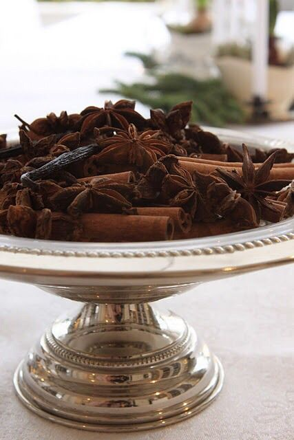 a silver bowl with anise stars and cinnamons sticks for a wonderful smell