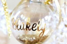 19 glitter filled ornament with a name