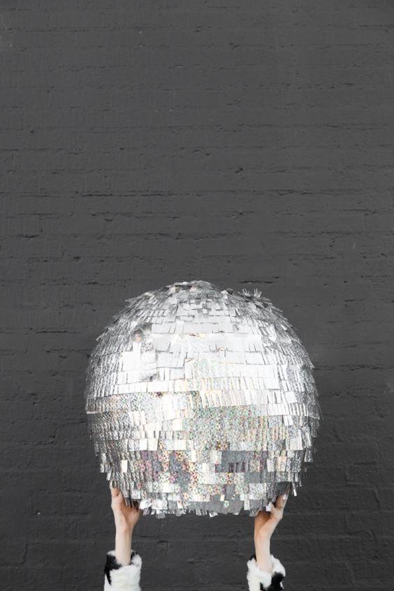 silver disco ball pinata for a party
