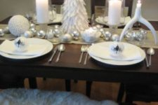 19 table setting with a felt Christmas tree and white and silver ornaments on the table runner