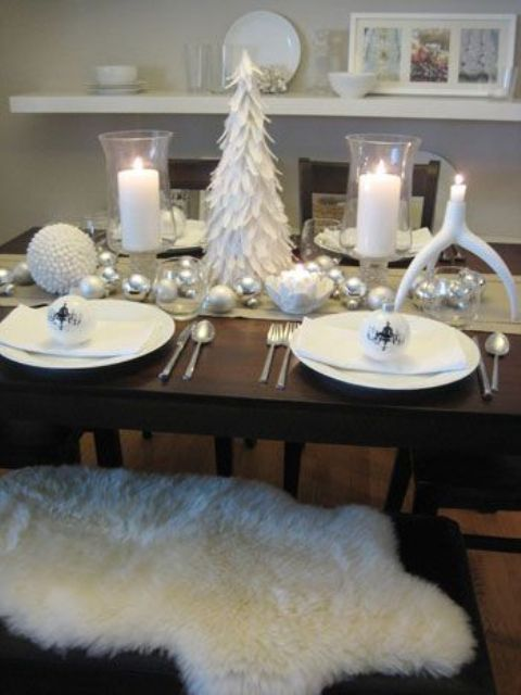 table setting with a felt Christmas tree and white and silver ornaments on the table runner