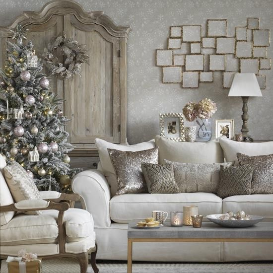 a snowy christmas tree decorated in silver and gold for a refined room