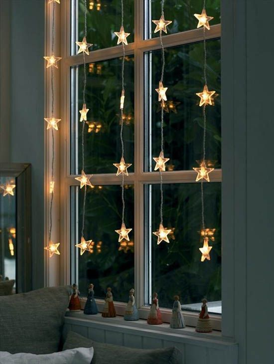 beautiful star light garlands on the window