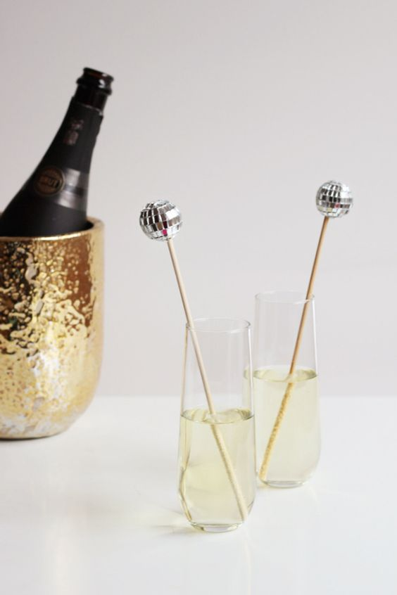 silver disco ball drink stirrers
