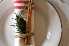 20 striped napkin, cinnamon sticks and evergreens for a rustic place setting