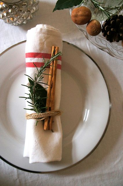 striped napkin, cinnamon sticks and evergreens for a rustic place setting