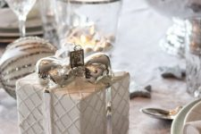 20 white and silver Christmas table with gift boxes and candles