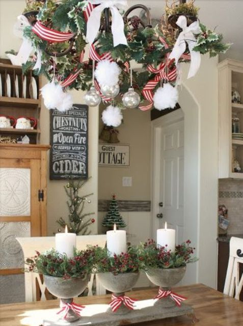 Christmas decorated chandelier and small pots with candles