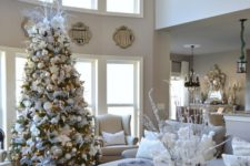21 a snowy-looking Christmas tree looks posh in a neutral living room