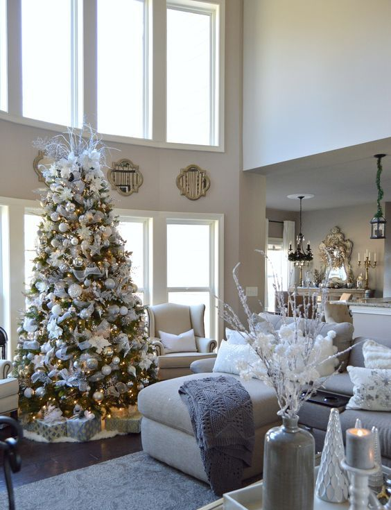 a snowy-looking Christmas tree looks posh in a neutral living room