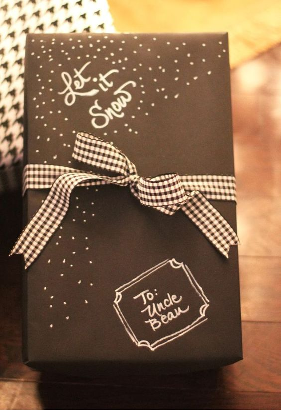 decorate simple black paper with a white sharpie and black and white ribbon