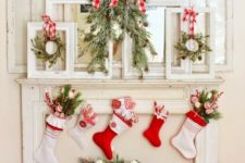 21 frames with wreaths hanging and stockings