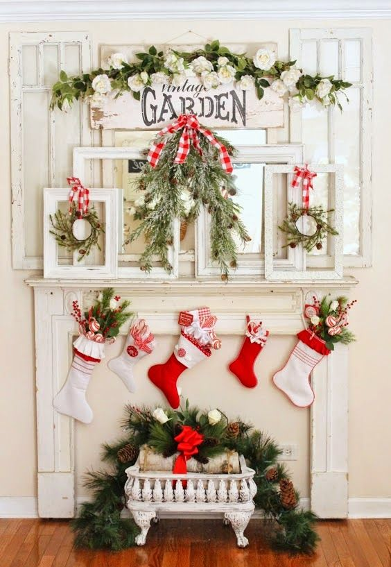 frames with wreaths hanging and stockings