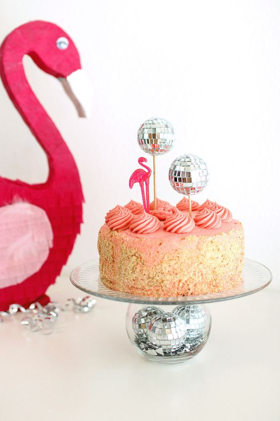 top a cake with disco balls and put some of them into a glass vase