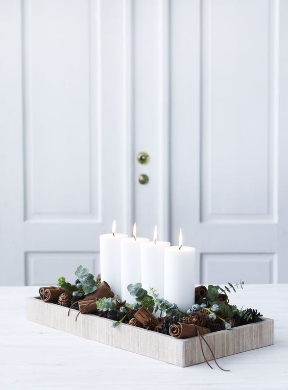 tray with candles, eucalyptus and pinecones for modern decor