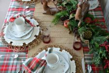 21 wicker placemats, pinecones, evergreens and nuts inside candle lanterns