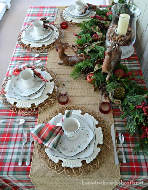 wicker placemats, pinecones, evergreens and nuts inside candle lanterns