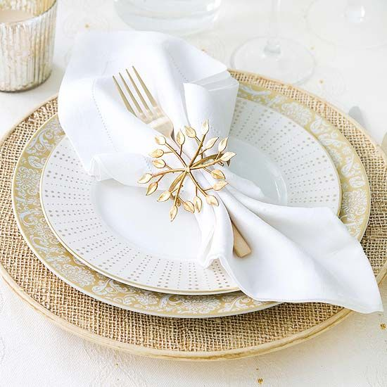 pretty gold snowflake with leafy parts for an elegant table setting