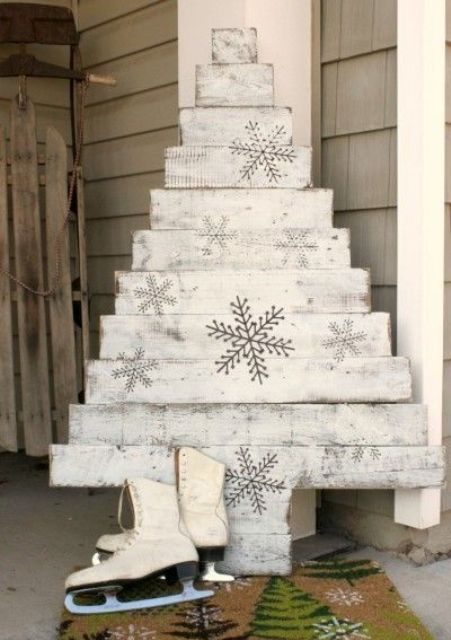 whitewashed pallet tree with snowflake stickers