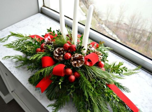 evergreens, red ribbon, pinecones and candles