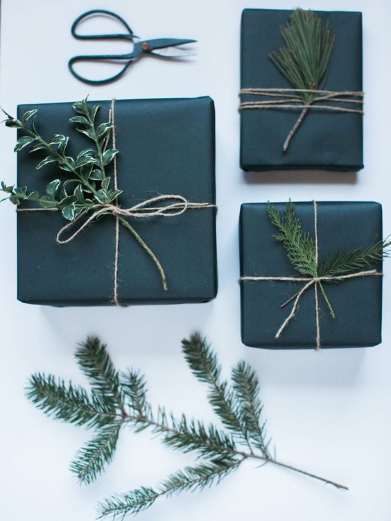 minimalist wrapping with black paper and evergreens