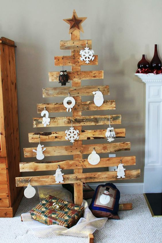 rustic pallet tree with white paper ornaments - Pallet Christmas Decoration Ideas