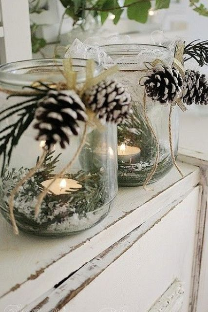 winter candle lanterns with pinecones and evergreens inside