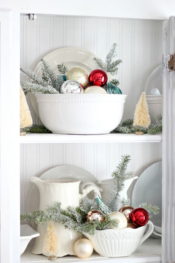 put ornaments into bowls and dishes in your galss cabinets