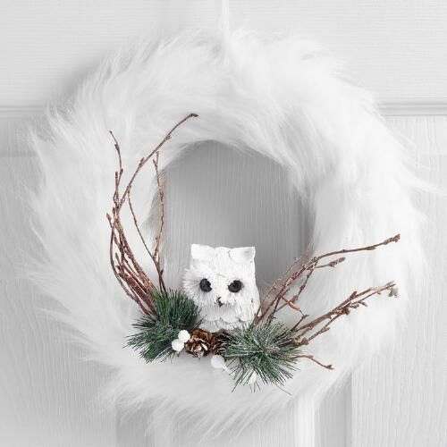 white faux fur wreath wwith an owl