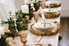 24 wood slices as placemats and moss and candle table runner
