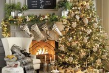 25 elegant large Christmas tree decorated in gold and white, with lights and pinecones