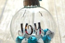 25 silver and blue jingle bell ornaments with sticker letters