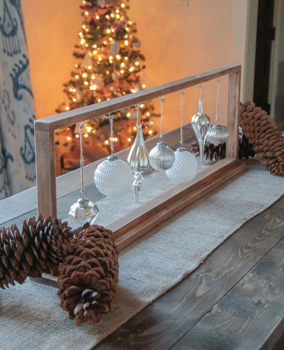 wooden frame with white and silver ornaments is a unique centerpiece