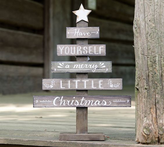 a natural wood slat small Christmas tree décor with a hand-painted white distressed star