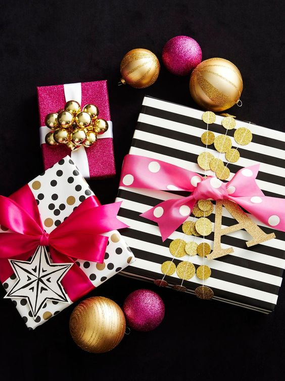 printed black, white and gold paper can be spruced up with glitter banners, pink ribbon and gift tags