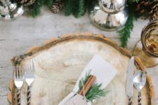 26 wood slices, cinnamon sticks and evergreens for topping a napkin