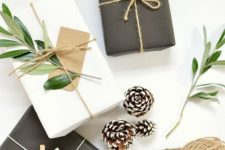 28 simple black or white wrapping paper looks amazing with twine, snowy pinecones and foliage