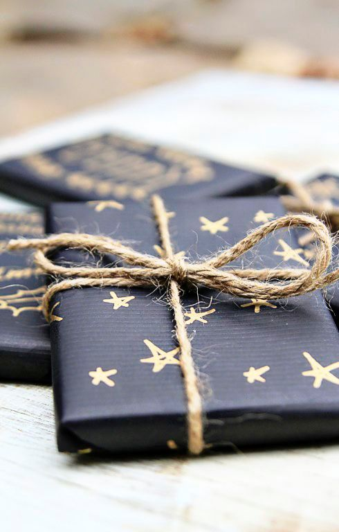 take black wrapping paper, a gold pen and pattern the paper as you like, add twine