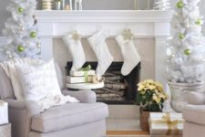 31 white tree in urns with bold ornaments for a chic frosted look