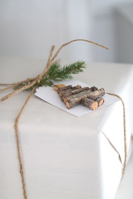 a topper made of stick pieces and evergreen twigs