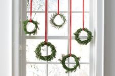 35 an assortment of small evergreen wreaths with red ribbon