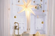 36 gold ornaments and an oversized shining star