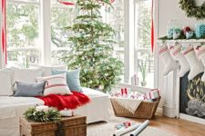 38 pretty small wreaths with red ribbon to frame the window and a coordinating tree