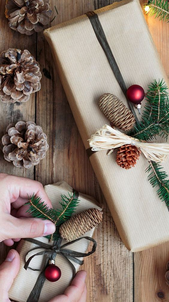 kraft paper, pinecones, evergreen sprigs and red ornaments