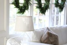 39 simple evergreen wreaths hanging symmetrically on the window