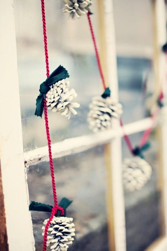 white pinecones on red strings for a simple and eye-catchy garland