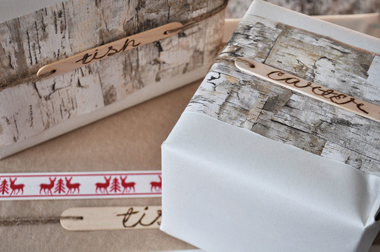 DIY Christmas gift wrapping with popsicle sticks (via www.seesawstore.com)