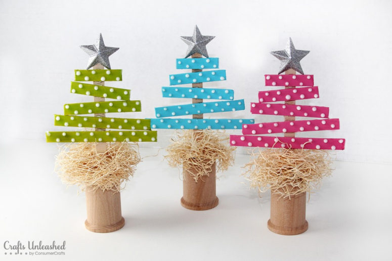 DIY colorful Christmas trees in pots (via blog.consumercrafts.com)