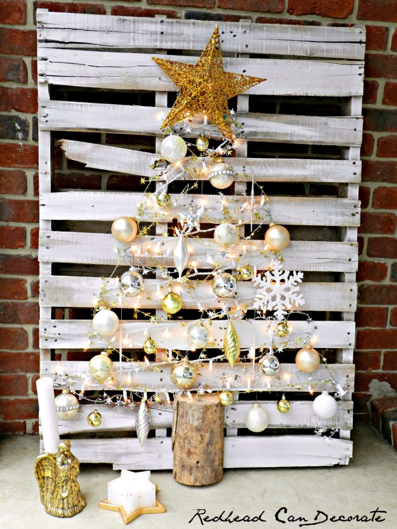 DIY pallet Christmas tree with metallic ornaments (via redheadcandecorate.com)