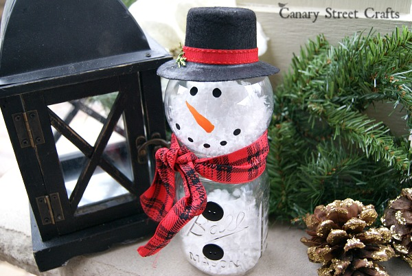 DIY mason jar and clear bauble snowman with faux snow (via canarystreetcrafts.com)